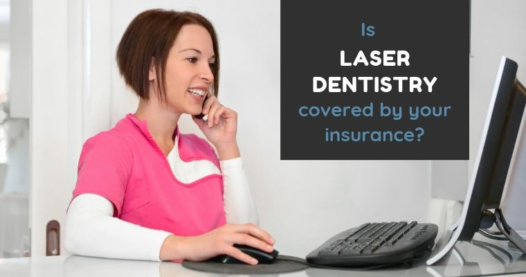 Dental office worker on computer checking on insurance coverage.