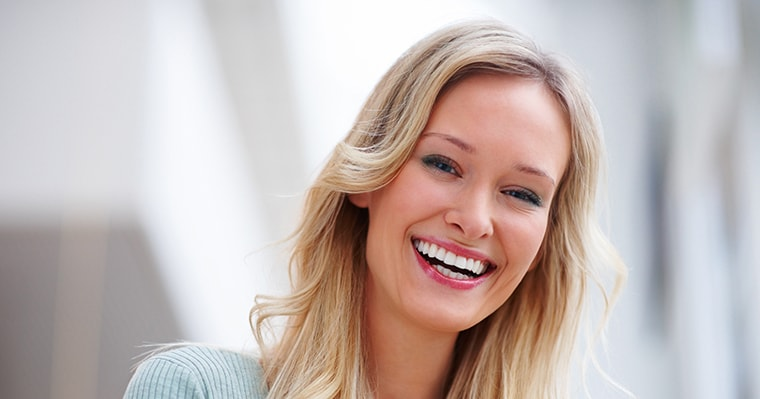 Blonde women smiling with white teeth